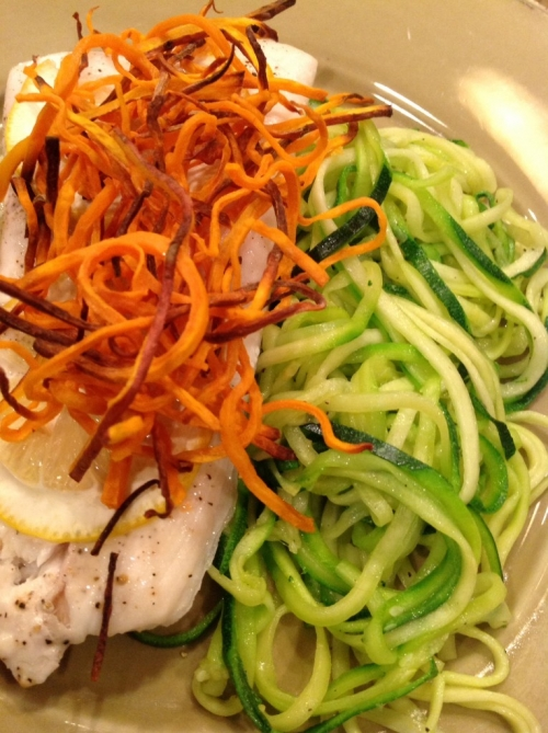 Baked halibut with zucchini zoodles topped with crispy yams